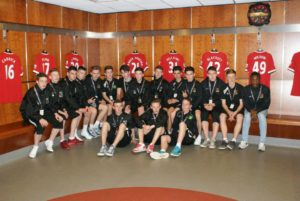 Knocklyon United team tour of Manchester United's changing rooms